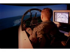 U.S. Navy F/A-18A Hornet simulator circa 1998 (Photos credits, www.vrssimulations.com (left), www.members.tripod.com/sims_freemen/ (right))