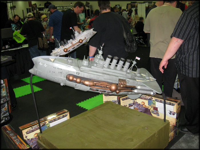 "The oversize battleship ""mini"" outside the Catalyst booth."