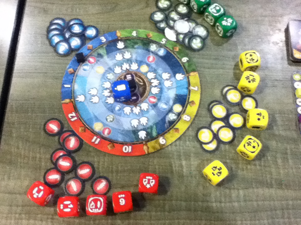 The season track at the middle tracks turns and displays mana conversions.  The dice are used basd on the season to roll and distrubute mana and/or other actions to the players.
