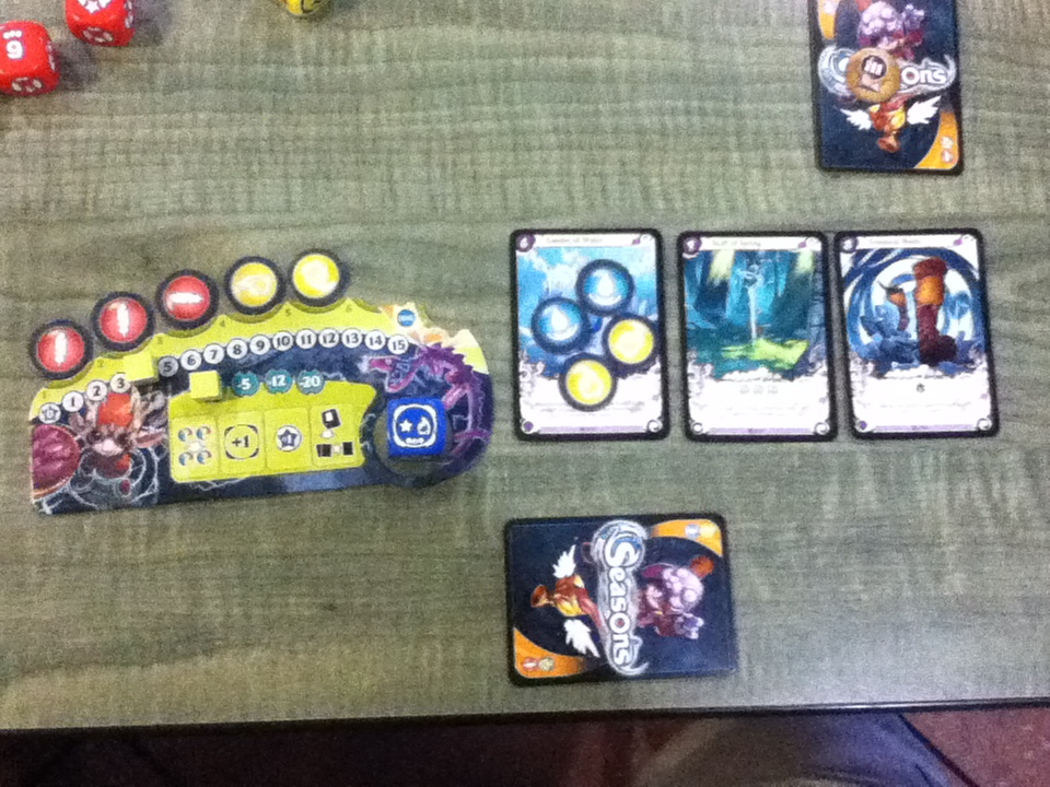 Each player has a mana track that also includes special abilities and the cost to use them.  Cards in play are placed in front of the player.