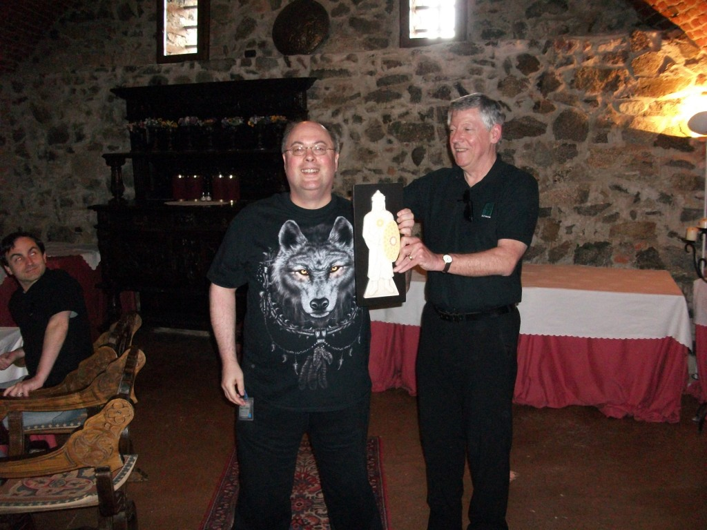 Fighting for Glory, Boggit receives the Saracen Warrior Trophy from Slitherine's CEO. JD McNeil