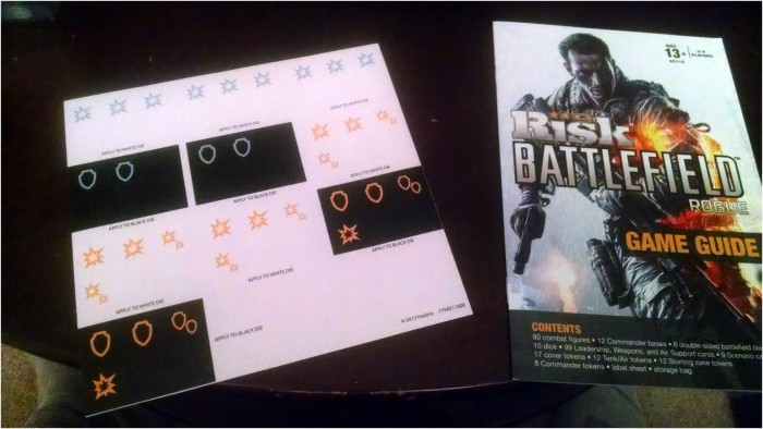 There's a sheet of stickers, and the rulebook.