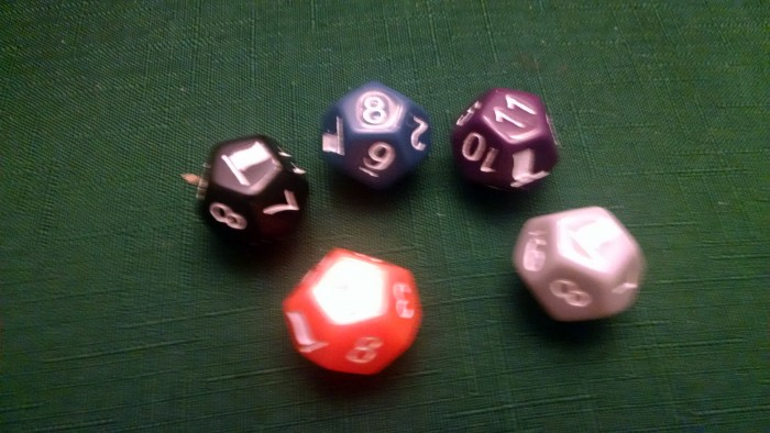Dice are color-coded for maximum flash glare.  And they match the meeples, too.