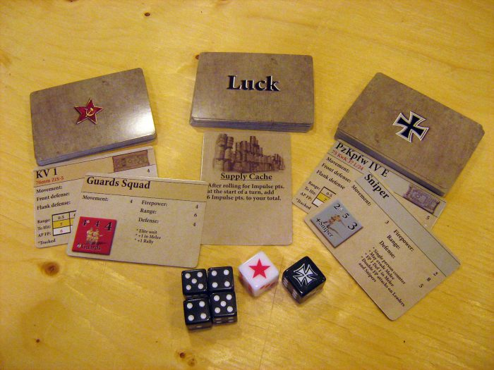 Two equipment decks, a Luck deck and four dice. Plus two huge KS dice for those big important rolls!