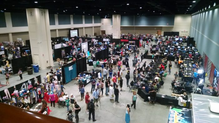 Looking over the gaming hall. Booths in the front, video games on the right, and tabletops in the back.